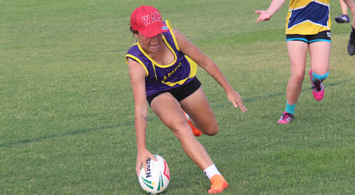 Eileen Roberts plants the ball down for one of her four tries in Agies Ladies' 10-0 win against Emus yesterday in round three of the Narrabri Touch Inc summer season at Cooma Oval.