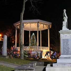 Standing Guard Over Christmas by Lena Arkell - Public Holidays Christmas ( gazebo, soldier, nova scotia, statue, monument, lunenburg, christmas, trees, lights,  )