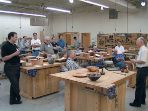 Photo: President Phil Brown conducts the business meeting at our Woodworkers Club location.