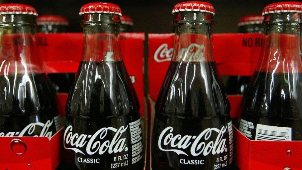 SAN FRANCISCO - JANUARY 16: Bottles of Coca-Cola are seen on the shelf at Tower Market January 16, 2004 in San Francisco, California. Coca-Cola is being investigated by U.S. regulators over allegations raised by a former employee that it had inflated its earnings.