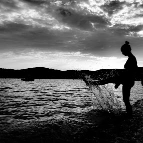 Kick by Nikola Bogdanic - People Portraits of Women ( clouds, girl, silhouette, bw, sea )