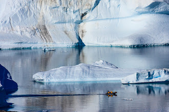 """Photo: Another shot from the Arctic. Some of the icebergs we encountered were well over a mile long, but it was generally very difficult to capture the enormity of them in a photograph.  Even though the icebergs shown here (including the """"big"""" one at the back) were relatively small, this was one of the very few occasions I was able get above the action and include some people to give an idea of scale.  #TravelThursday, curated by +Laura Mitchum #ThirstyThursday, curated by +Giuseppe Basile and +Mark Esguerra"""