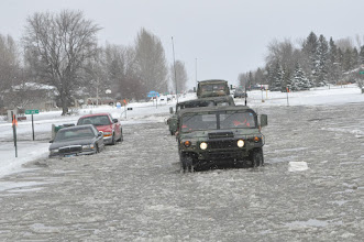Photo: A Minnesota National Guardsmen patrolled the streets of Moorhead, Minn. during Flood Fight 2009 on March 27.