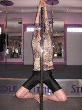 Photo: Iris Aged 72yrs do vertical pole gymnastics - Double Arm Hand with Triangle Legs