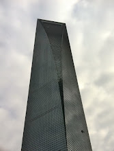Photo: This is the outside of the Shanghai World Financial Center. Nearly a half kilometer straight up. That's where we're going next...