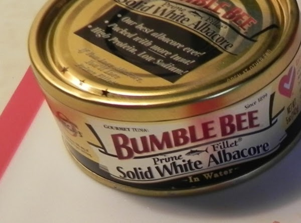 Drain your solid white Albacore Tuna in water or oil. Pour a small amount...