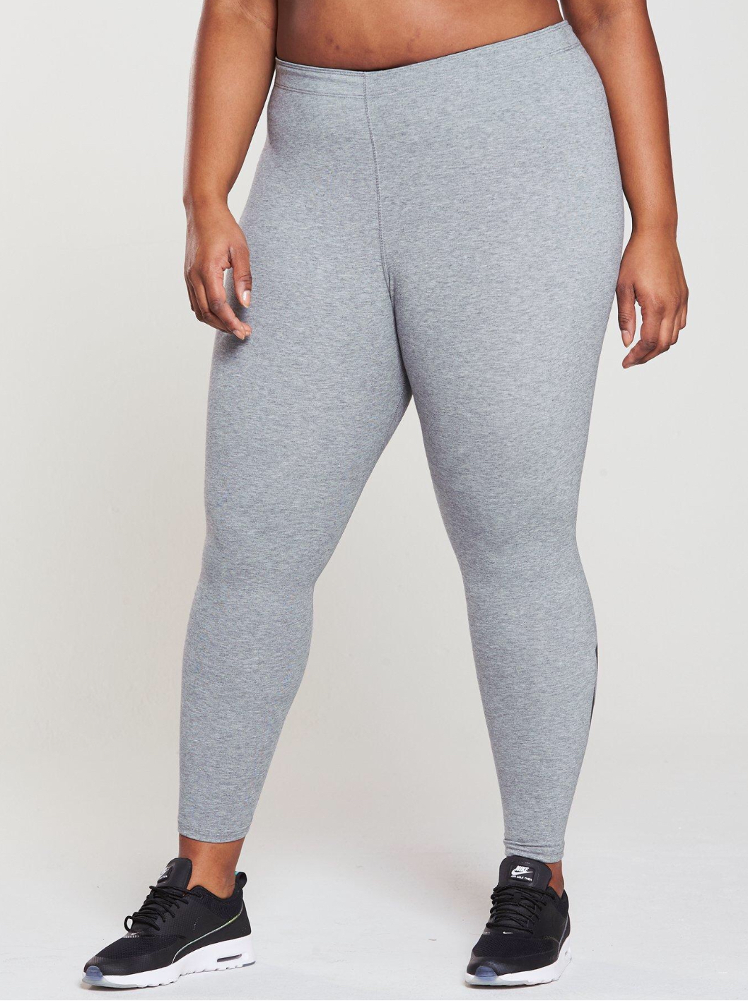 A woman is wearing grey leggings