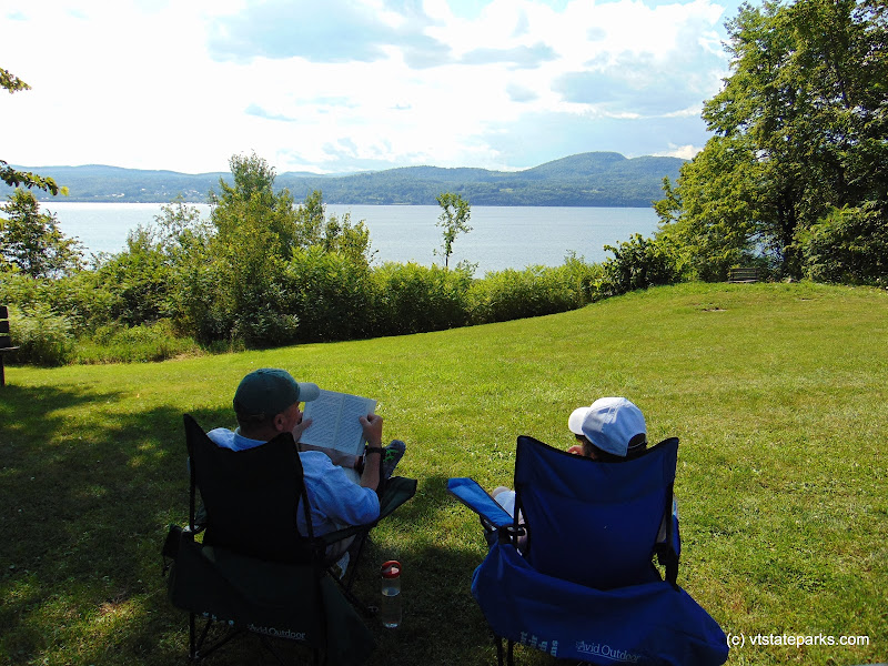 Photo: Couple enjoys a relaxing moment reading by the lake at DAR State Park by Belinda Lafountain