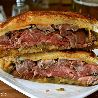 Pub-Style Steak Grilled Cheese with Beer-Braised Onions & Creamy Horseradish Dipping Sauce.