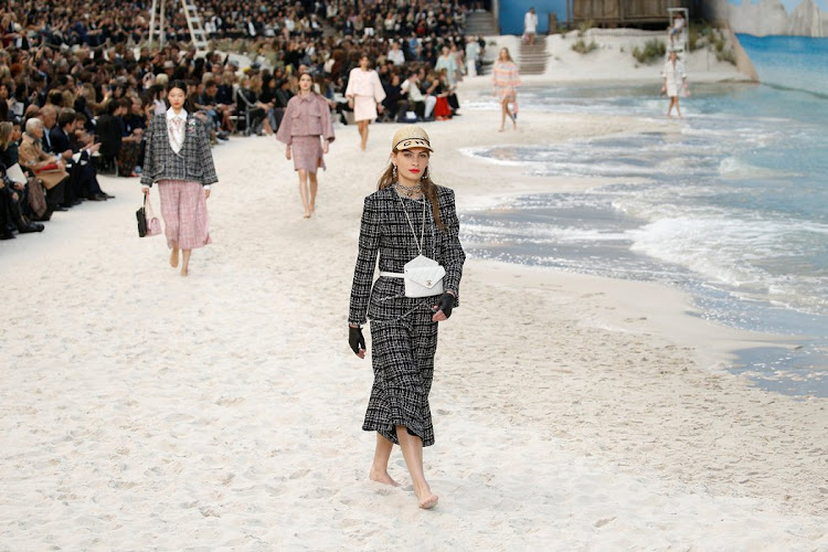 The Grand Palais transformed into a beach scene at Paris Fashion Week.