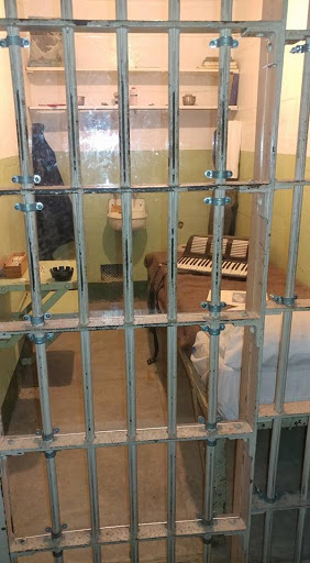 alcatraz-prison-cell2-1.jpg - A cell for well-behaved prisoners included books, musical instruments and a real pillow, mattress and blanket.