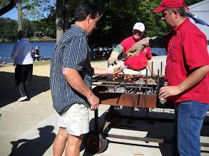 Photo: Richard Rumbaugh serves up the hotdogs.