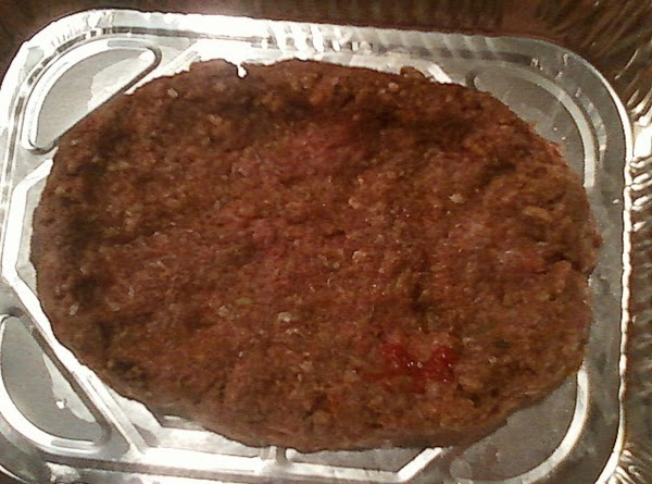 Mix all meatloaf ingredients in a large bowl.  Take 1/2 of the meat...
