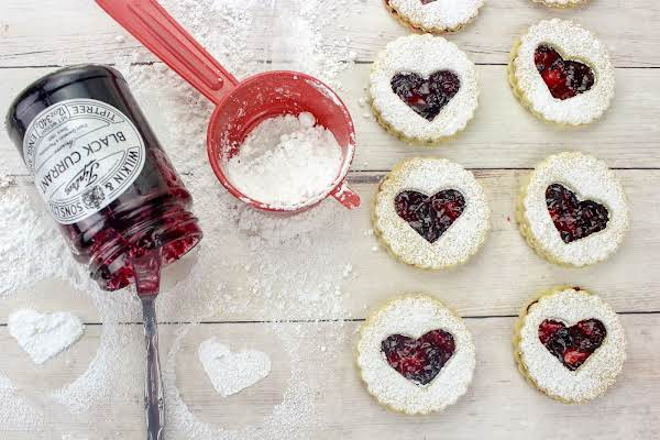 German Linzer Cookies Dusted With Powdered Sugar And Filled With Jam.