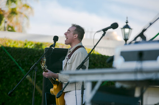 Ted Leo on stage.jpg - Ted Leo helps kick off things during the hours-long music concert and food festival.