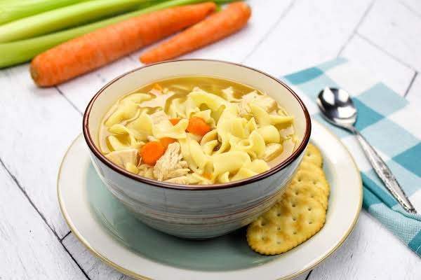 Homemade Chicken Soup In A Bowl With Crackers.