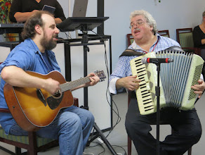Photo: Barry Durbin on guitar and Ismail Butera entertained. Both are artists-in-residence at New York Memory Center.