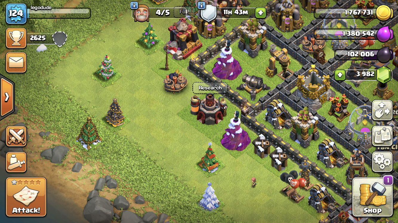 Clash of Clans' village with six different types of Christmas trees.