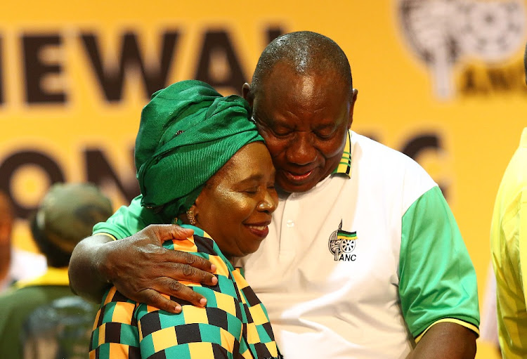 Cyril Ramaphosa hugs Dr Nkosazana Dlaminiu Zuma after he won the ANC Preesidential race during the 54th ANC Elective Conference in Nasrec.