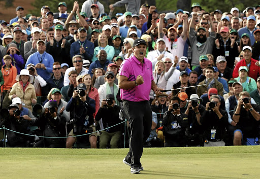 Crowd favourite: Patrick Reed is joined by a cheering gallery as he wins the Masters at Augusta on Sunday. Picture: REUTERS