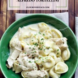 Crock Pot Creamy Chicken Alfredo Tortellini.