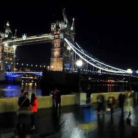 Passing Tower Bridge by DJ Cockburn - Buildings & Architecture Bridges & Suspended Structures ( lights, south bank, thames, promenade, tower bridge, night, bridge, walk, motion blur,  )