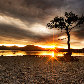 by Andrew Percival - Landscapes Sunsets & Sunrises ( clouds, scotland, sky, waterscape, sunset, summer, loch, landscape, sun, filter )