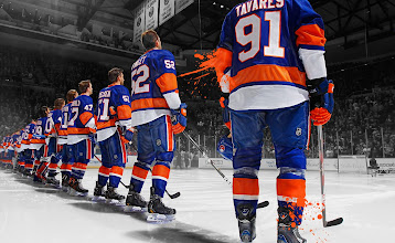 Photo: UNIONDALE, NY - JANUARY 19: The New York Islanders line up prior to the 2013 home opener game against the New Jersey Devils at Nassau Veterans Memorial Coliseum on January 19, 2013 in Uniondale, New York. The Devils defeated the Islanders 2-1. (Photo by Mike Stobe/NHLI via Getty Images)