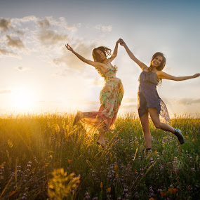 Jumping for joy! by Shirley Cohen - People Street & Candids ( field, friends, sunset, friendship, bffs, flowers, together, energy,  )