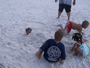 Photo: Miles is buried - everyone helping.