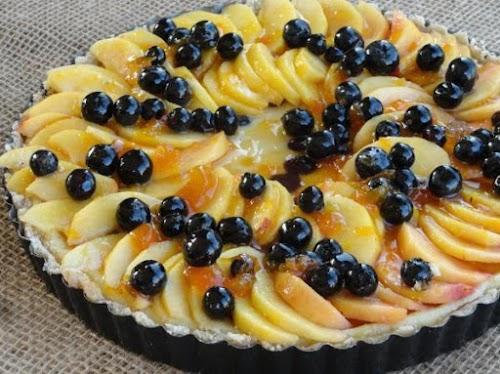 "Drunken Blueberry Peach Cheesecake Tart ""Blueberries, peaches, cheesecake on a nut crust,..."