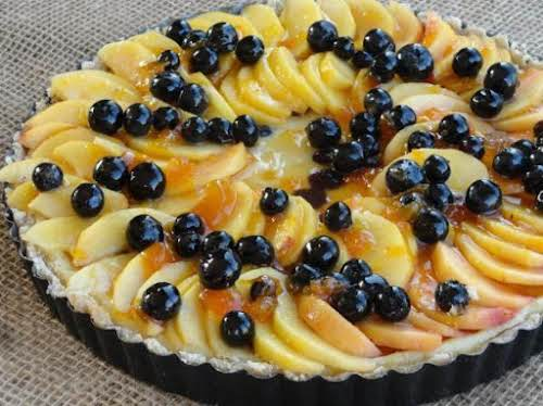 "Drunken Blueberry Peach Cheesecake Tart ""Blueberries, peaches, cheesecake on a nut crust,..."