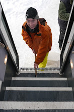 Photo: Colter is on the job as usual, this time removing ice and snow from the stairs of our snow coach.