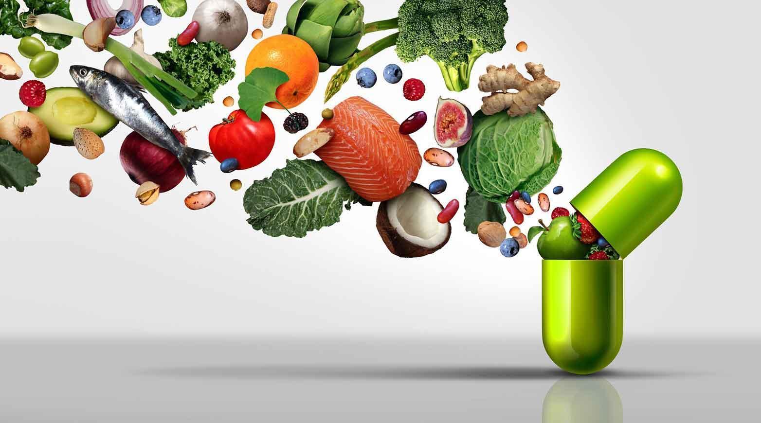 Complément nutritionnel et suppléments vitaminiques sous forme de capsule contenant des fruits, des légumes et des haricots à l'intérieur d'une pilule nutritive en tant que traitement de santé en médecine naturelle avec des éléments d'illustration 3D.