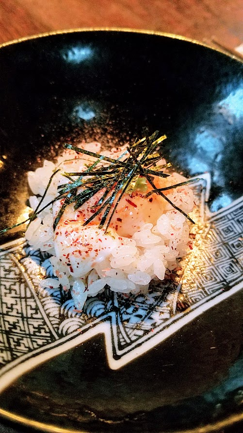 Fukami 19 course dinner of small plates and sushi: Onzen Uzura and Shari, soft poached quail egg over warm sushi rice with freshly grated wasabi, shoyu and itogaki