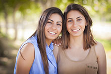 Portrait of mixed race twin sisters.