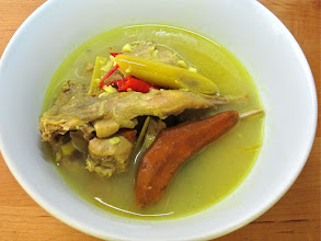 Photo: close-up of southern-style turmeric quail soup