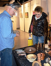 Photo: She brought a precious but wobbly spin top and asked Mike if he could fix it.