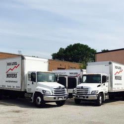 Two Hino delivery trucks parked outside of Somerville Hino