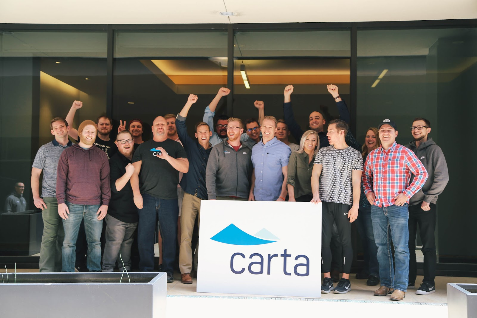 Carta team gathering in front of their headquarters
