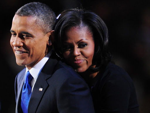 Former US First Lady Michelle Obama hugs former US President Barack Obama./file