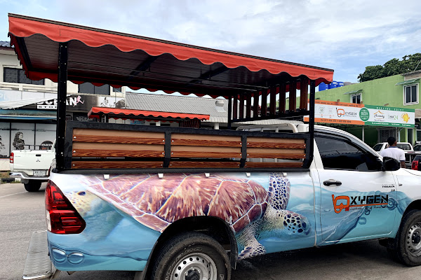 Convenient pickup service by local truck from your hotel on Koh Tao