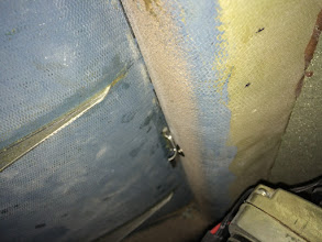 Photo: A blurrier picture of a crappy front compartment latch.