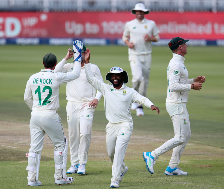 Quinton de Kock and Temba Bavuma celebrate the dismissal of Kusal Perera.
