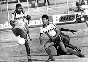 Jackie Masike clears in front of Brian Stoddart of Arcadia Pepsi  on July 26 1981.