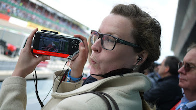 Photo: Flora Graham recreates a 55-inch LCD TV by holding a far smaller screen very close to her face