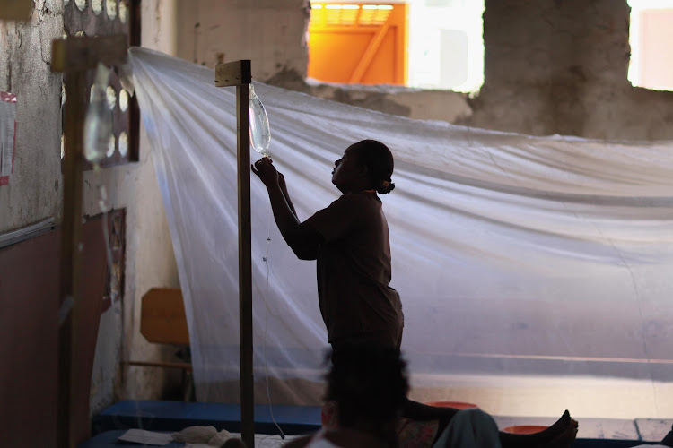 A nurse changes the intravenous solution for a cholera patient in a cholera treatment facility in the slum neighbourhood of Cite Soleil in Port-au-Prince, Haiti. File photo.