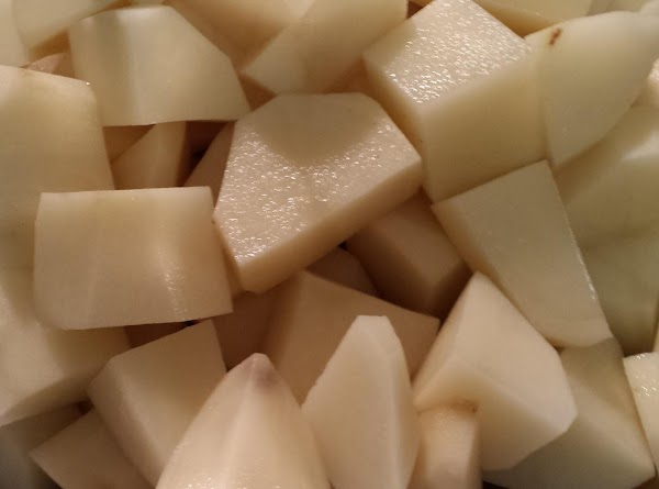 Add the cubed potatoes and stir to coat.