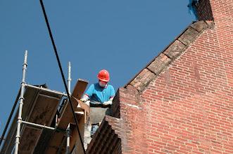 Photo: June 2005 - Month 22: Repairing the masonry under the metal cap