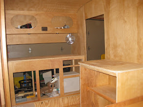 Photo: Front cabinet faces in place, and fan mounted.